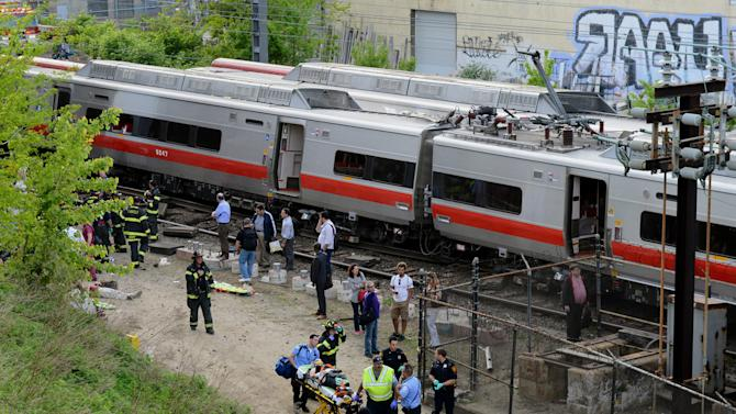 Injured passengers are removed from the scene of a train collision, Friday, May 17, 2013 in Fairfield, Conn. Two commuter trains serving New York City collided in Connecticut during Friday's evening rush hour, injuring about 50 people, authorities said. There were no reports of fatalities. (AP Photo/The Connecticut Post, Christian Abraham) MANDATORY CREDIT