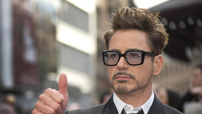 """FILE - This April 18, 2013 photo shows actor Robert Downey Jr at the UK premiere of """"Iron Man 3,"""" in central London. Marvel announced Thursday, June 20, that the actor will reprise his role as Iron Man/Tony Stark for both """"The Avengers 2"""" and """"The Avengers 3."""" Downey Jr. has played the character in a trilogy of """"Iron Man"""" films, as well as the first """"Avengers"""" film,"""" which made $2.7 billion worldwide. (Photo by Joel Ryan/Invision/AP, file)"""