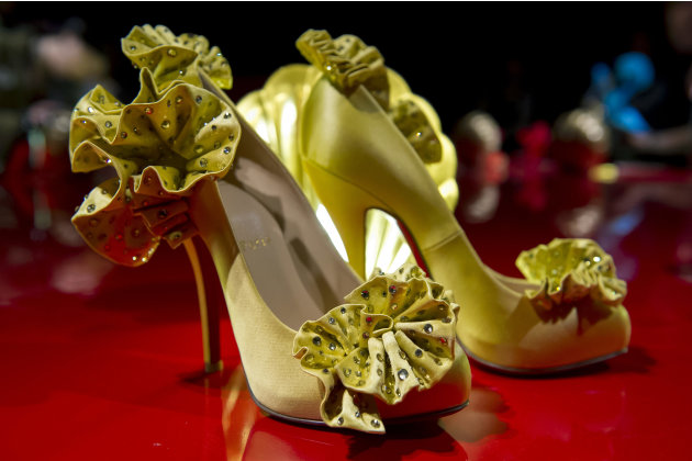 French shoe designer, Christian Louboutin, opens his first ever retrospective exhibition, at the Design Museum, London, Monday, April 30, 2012. The exhibition will be the first comprehensive presentat
