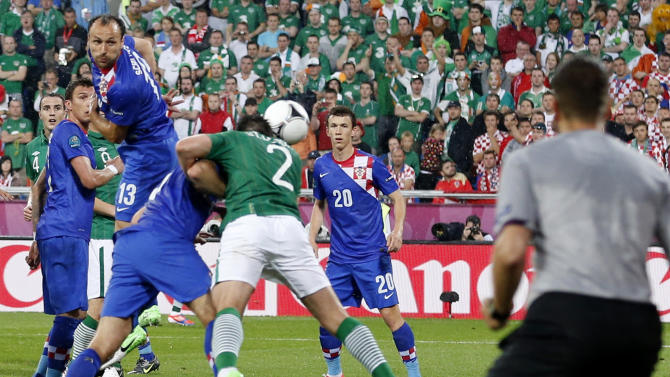 Ireland's Sean St. Ledger, (2), scores  a  goal during the Euro 2012 soccer championship Group C match between the Republic of Ireland and Croatia in Poznan, Poland, Sunday, June 10, 2012. (AP Photo/Antonio Calanni)