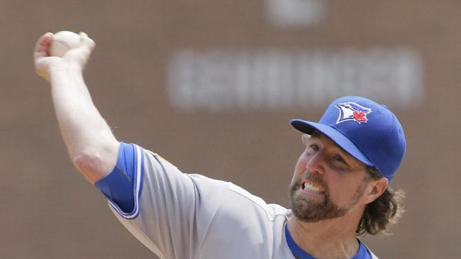 Toronto Blue Jays' R.A. Dickey pitches against the Detroit Tigers during the first inning of a baseball game Saturday, July 4, 2015, in Detroit. (AP Photo/Duane Burleson)