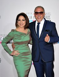 FILE - The Nov. 18, 2012 file photo shows singer Gloria Estefan, left, and Emilio Estefan, Jr. at the 40th Anniversary American Music Awards in Los Angeles. Gloria Estefan and her husband Emilio Estefan are hoping to develop a stage musical about their lives. The duo on Tuesday announced that they&#39;ve also teamed up with the Nederlander Organization to try to take the show to Broadway. (Photo by John Shearer/Invision/AP, file)