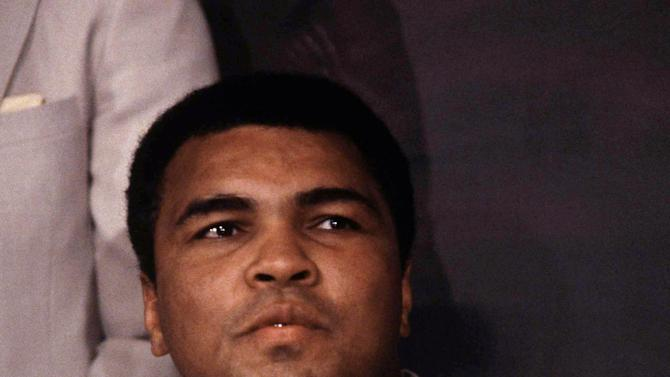 FILE -In this 1984 file photo, Muhammad Ali is shown. Ali has pleaded with the government of Iran to release two American hikers arrested in 2009 and charged with spying. The Feb. 1 letter asks Khameini to release Josh Fattal and Shane Bauer, who were arrested while hiking in northern Iraq near the Iranian border. A third hiker, Sarah Shoud, was released on bail in September, shortly after Ali first wrote to Khamenei.  (AP Photo/Mario Cabrera, File)