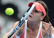 Agnieszka Radwanska of Poland returns a shot against Li Na of China during their semi-final match at the Sydney International on January 10, 2013. Radwanska clinched a 6-3, 6-4 victory in one hour and 32 minutes on the Ken Rosewall Arena
