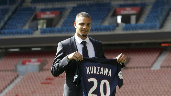 New Paris St Germain's player Kurzawa poses at the Parc des Princes stadium after a news conference in Paris