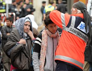 Medical staff check migrants after their arrival at…
