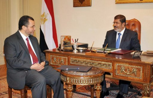 Egyptian President  Mohamed Morsi (right) meets with Prime Minister Hisham Qandil on July 24 in Cairo