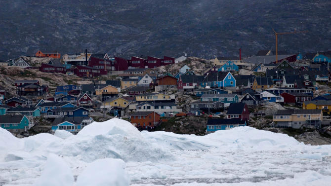 In this July 18, 2011 photo, floating ice, left over from broken-up icebergs shed from the Greenland ice sheet, nearly cover the seafront in Ilulissat, Greenland. (AP Photo/Brennan Linsley)