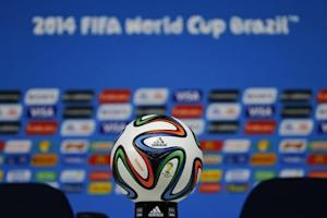 """The official match ball for the 2014 World Cup, the """"Brazuca"""" , is displayed on the table before a news conference at the Corinthians arena in Sao Paulo"""