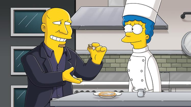 "Marge fantasizes about being a contestant on ""Top Chef"" hosted by Tom Colicchio (guest voicing as himself) in the all-new ""The Falcon and the D'Ohman"" season premiere episode of ""The Simpsons."""