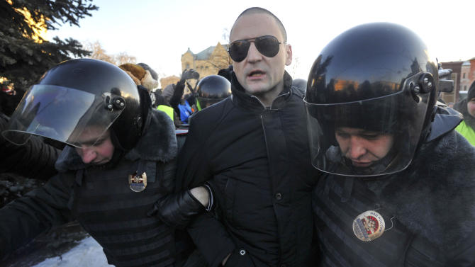 Opposition leader Sergei Udaltsov is detained by police during an unauthorized rally in Lubyanka Square in Moscow, Saturday, Dec. 15, 2012. Thousands of opposition supporters gathered Saturday in central Moscow for an unauthorized rally to mark a year of a wave of massive protests against Vladimir Putin and the government. Several prominent opposition figures were detained in the course of the gathering, which was not sanctioned by authorities. (AP Photo)