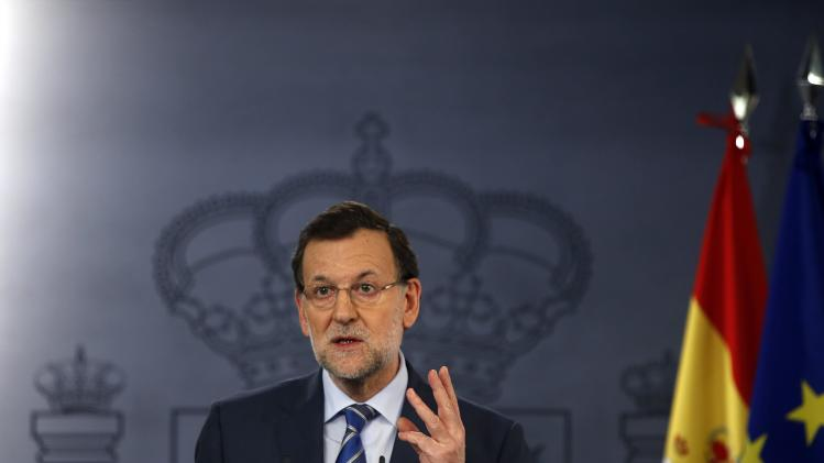 Spain's Prime Minister Mariano Rajoy gestures during a news conference at Madrid's Moncloa Palace