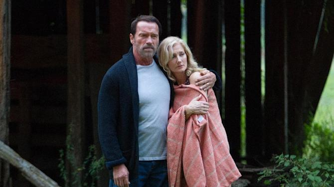 """In this image released by Roadside Attractions, Arnold Schwarzenegger, left, and Joely Richardson appear in a scene from """"Maggie."""" (Tracy Bennett/Roadside Attractions via AP)"""