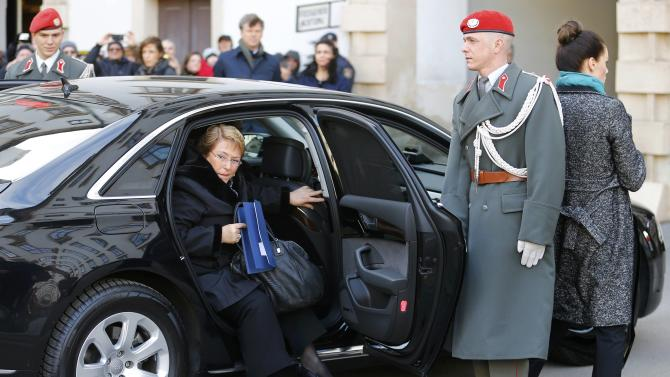 Chile's President Bachelet steps out of her limousine for a state visit in Vienna