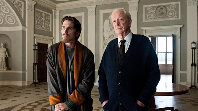 "FILE - This undated image released by Warner Bros. Pictures shows Christian Bale as Bruce Wayne, left, and Michael Caine as Alfred in a scene from the ""The Dark Knight Rises."" Studio executives expected their biggest summer ever this year. What they got were two colossal hits (""The Avengers"" and ""The Dark Knight Rises""), a solid slate of back-up blockbusters (among them ""The Amazing Spider-Man"" and ""Ted"") and plenty of duds (""Battleship,"" ""Total Recall"") that just didn't deliver. (AP Photo/Warner Bros. Pictures, Ron Phillips, File)"