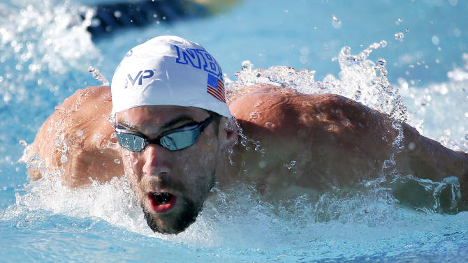 Michael Phelps warms up prior to competing in the men's 200-meter individual medley final, Saturday, April 18, 2015, at the Arena Pro Swim Series in Mesa, Ariz. (AP Photo/Matt York)