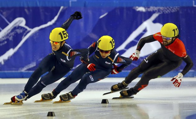 Sin of South Korea of South Korea competes to win in front of second placed compatriot Kim and third placed Hamelin of Canada during the men's 1500m finals at the ISU World Short Track Speed Skating C