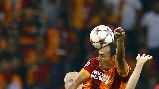 Deschacht of Anderlecht challenges Bulut of Galatasaray during thier Champions League Group D soccer match in Istanbul