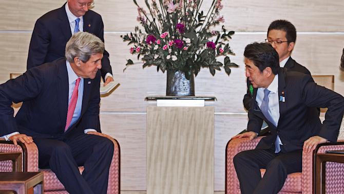 U.S. Secretary of State John Kerry, left, and Japanese Prime Minister Shinzo Abe sit down for their meeting at Abe's official residence in Tokyo Monday, April 15, 2013. Kerry is in Tokyo as part of Asian tour amid a tense situation over a possible missile launch by North Korea. (AP Photo/Paul J. Richards, Pool)
