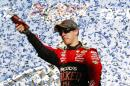 Brad Keselowski celebrates after winning the NASCAR Sprint Cup Series auto race at Talladega Superspeedway, Sunday, Oct. 19, 2014, in Talladega, Ala. (AP Photo/Brynn Anderson)
