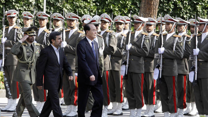 The president of the Presidium of North Korea's Supreme People's Assembly Kim Yong-nam, center, reviews an honor guard alongside Iranian President Mahmoud Ahmadinejad, second left, during an official welcoming ceremony in Tehran, Iran, Saturday, Sept. 1, 2012. Kim Yong Nam attended the Nonaligned Movement summit in Tehran on Thursday and Friday. (AP Photo/Vahid Salemi)