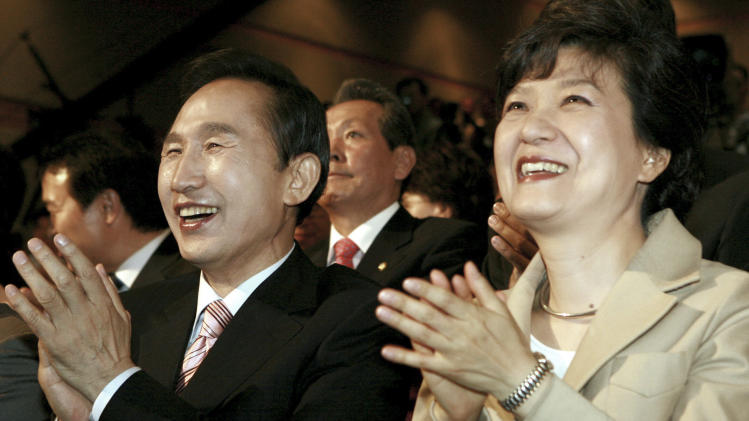 """FILE - In this Tuesday, May 29, 2007 file photo, South Korea's opposition Grand National Party presidential contenders Lee Myung-bak, left, and Park Geun-hye clap as they participate in a public hearing in Kwangju, south of Seoul, South Korea. Park served five terms in the legislature and earned the nickname """"Queen of Elections"""" for her ability to win tight races. She only narrowly lost in presidential primaries five years ago to current conservative President Lee, whose single term ends in February. Park attempts to become the country's first female president and keep the government in conservative hands in the Dec. 19, 2012 election. (AP Photo/Yonhap, Baek Sung-ryul, File) KOREA OUT"""