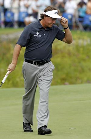 Phil Mickelson reacts to making a birdie putt on the 18th green during the first round of the Deutsche Bank Championship golf tournament in Norton, Mass., Friday, Aug. 30, 2013. (AP Photo/Stew Milne)