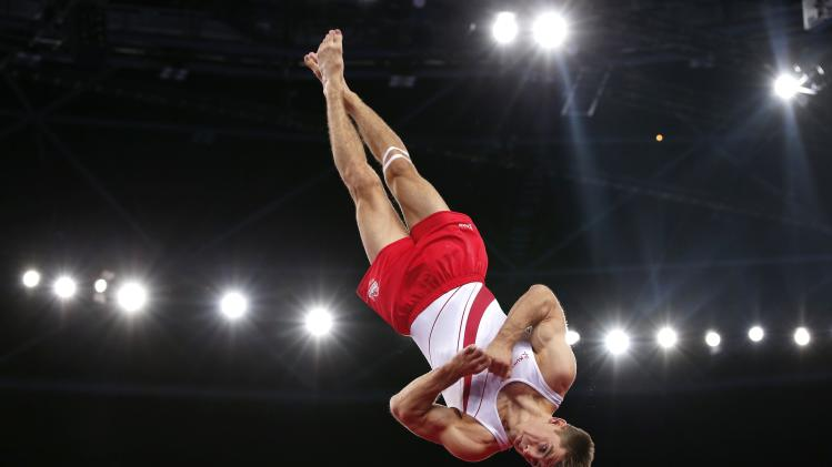 Max Whitlock of England performs during the floor apparatus men's gymnastics final at the 2014 Commonwealth Games in Glasgow