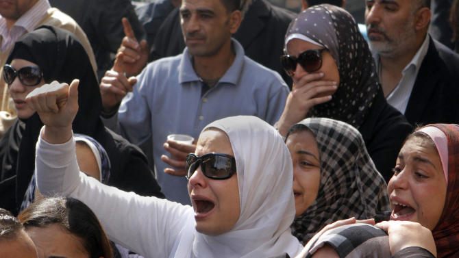 Egyptian relatives of Mohammed Saad, a 20-year-old protester, who died of wounds sustained during clashes last Friday near the presidential palace, grieve during his funeral procession in Tahrir Square, Cairo, Egypt, Monday, Feb. 4, 2013. More than 60 people have died in recent protests across Egypt that began on Thursday, Jan. 24, 2013, the eve of the second anniversary of the start of the uprising that toppled autocrat Hosni Mubarak. (AP Photo/Amr Nabil)