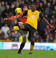Blackburn Rovers&#39; Nigerian striker Ayegbeni Yakubu, right, vies with Manchester United&#39;s Brazilian defender Rafael Da Silva during the English Premier League match on New Year&#39;s Eve. Yakubu scored twice as Rovers stunned United 3-2 at Old Trafford