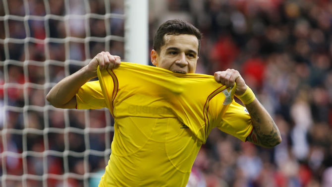 Football: Philippe Coutinho celebrates after scoring the first goal for Liverpool
