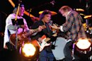 Musician Neil Young, right, performs with his band Crazy Horse including Frank Sampedro, left, and Ralph Molina, at the Global Citizen Festival in Central Park on Saturday Sept. 29, 2012 in New York. (Photo by Evan Agostini/Invision/AP)