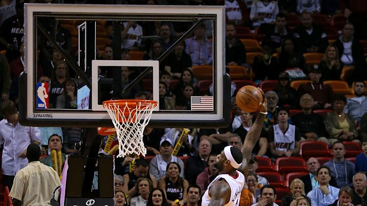 Heat rally late to get past Celtics, 93-86