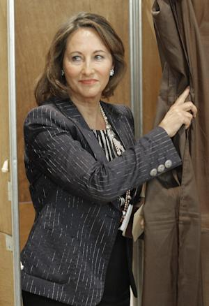 French former Socialist presidential candidate Segolene Royal holds her ballot for the elections Sunday, June 17, 2012, in  La Rochelle, west of France. Royal is facing a Socialist Party opponent in the second round election, and will determine the makeup of the new parliament. (AP Photo/Jacques Brinon)