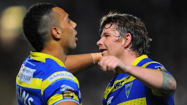 RUGBY LEAGUE Warrington Wolves' Ryan Atkins and Lee Briers celebrate victory