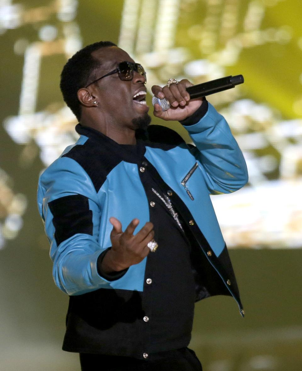Rappers Diddy, left, also known as Sean Combs, performs during the BET Hip Hop Awards, Saturday, Sept. 28, 2013, in Atlanta. (AP Photo/David Goldman)