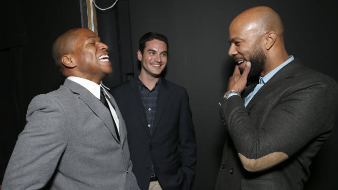 "Director Sheldon Candis, Producer Jason Michael Berman and Common attend the LA premiere of ""Luv"" at the Pacific Design Center on Thursday, Jan. 10, 2013, in West Hollywood, California. (Photo by Todd Williamson/Invision/AP)"