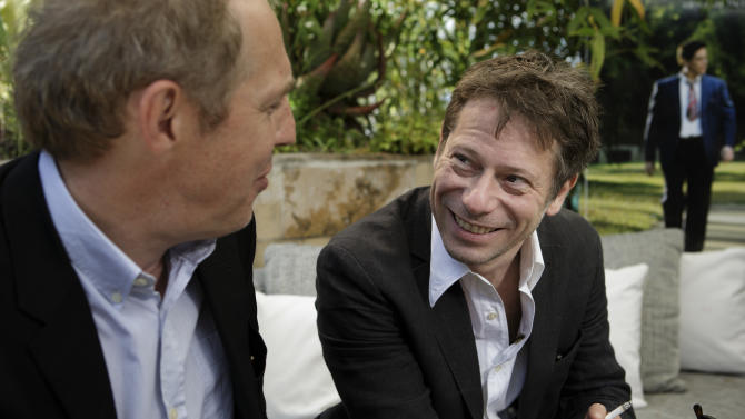 """In this photo taken Sunday, May 19, 2013, actor Mathieu Amalric, right, and director Arnaud Desplechin pose for photographs following an interview with The Associated Press at the 66th international film festival, in Cannes, southern France. Amalric depicts a maverick academic counseling Benicio Del Toro's Native American war vet in """"Jimmy P.: Psychotherapy of a Plains Indian,"""" director Arnaud Desplechin's Cannes Film Festival contender. (AP Photo/David Azia)"""