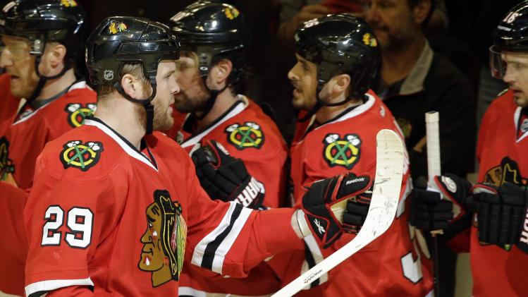Chicago Blackhawks' Bryan Bickell (29) celebrates with teammates after scoring a goal during the first period of Game 5 of the NHL hockey Stanley Cup playoffs Western Conference semifinals against the Detroit Red Wings in Chicago, Saturday, May 25, 2013. (AP Photo/Nam Y. Huh)