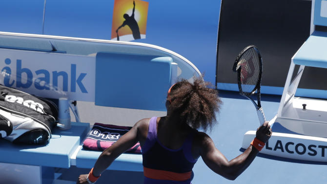 Serena Williams of the US throws her racquet after smashing it during her quarterfinal match against compatriot Sloane Stephens at the Australian Open tennis championship in Melbourne, Australia, Wednesday, Jan. 23, 2013. (AP Photo/Rob Griffith)