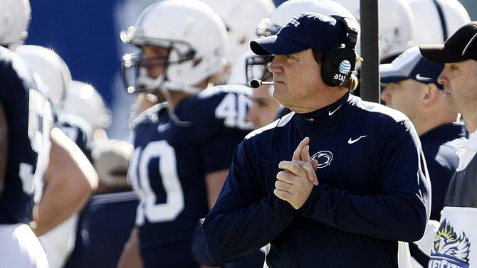 Penn State interim head coach Tom Bradley walks the sidelines during the first half of the TicketCity Bowl NCAA college football game against Houston, Monday, Jan. 2, 2012, at the Cotton Bowl in Dallas. Houston won 30-14. (AP Photo/Brandon Wade)