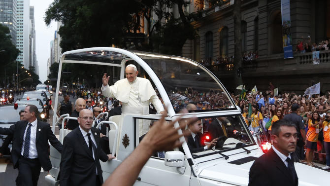 A crowd of faithful cheer as Pope Francis rides in his popemobile in Rio de Janeiro, Brazil, Monday July 22, 2013. The pontiff arrived for a seven-day visit in Brazil, the world's most populous Roman Catholic nation. During his visit, Francis will meet with legions of young Roman Catholics converging on Rio for the church's World Youth Day festival. (AP Photo/Victor R. Caivano)