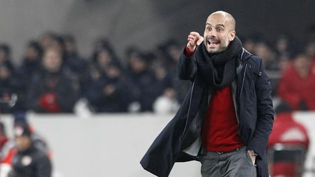 Bayern Munich's coach Pep Guardiola reacts during the German first division Bundesliga soccer match against Stuttgart in Stuttgart January 29, 2014 (Reuters)