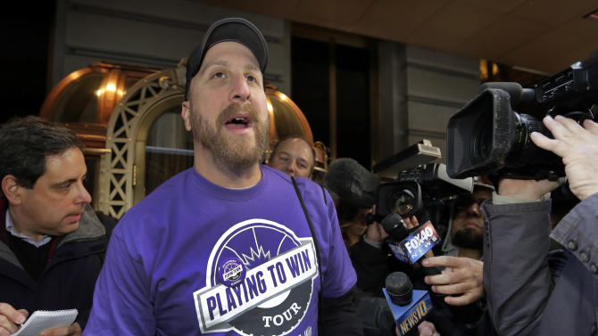 "Dave ""Carmichael Dave"" Weiglein, organizer of the ""Playing to Win"" tour RV, is interviewed outside the hotel where NBA owners are meeting regarding the possible relocation of the Sacramento Kings team to Seattle, in New York, Wednesday, April 3, 2013. Hedge fund manager Chris Hansen and Microsoft Chief Executive Steve Ballmer have agreed to buy a majority stake in the Kings from the Maloof family for $341 million, but the deal needs league approval. (AP Photo/Richard Drew)"