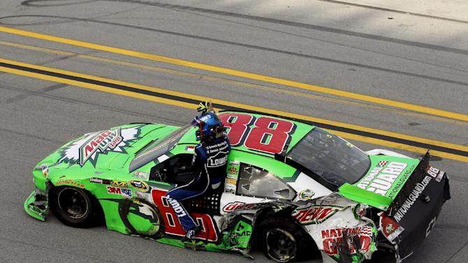 Dale Earnhardt Jr., (88) gives Jimmie Johnson a ride back to the pits after the NASCAR Sprint Cup auto race at Talladega Superspeedway in Talladega, Ala., Sunday, Oct. 7, 2012. (AP Photo/Tom Pennington, Pool)