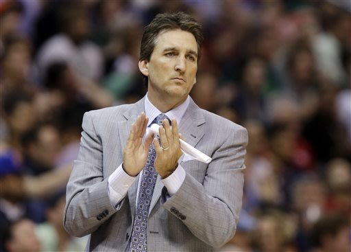 In this March 17, 2013, file photo, Los Angeles Clippers head coach Vinny Del Negro aplaudes during  the second half of an NBA basketball game against the New York Knicks in Los Angeles. Del Negro is
