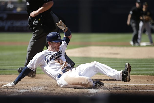 Chris Denorfia scores off a sacrifice fly by Carlos Quentin, the first Padres run. (AP)