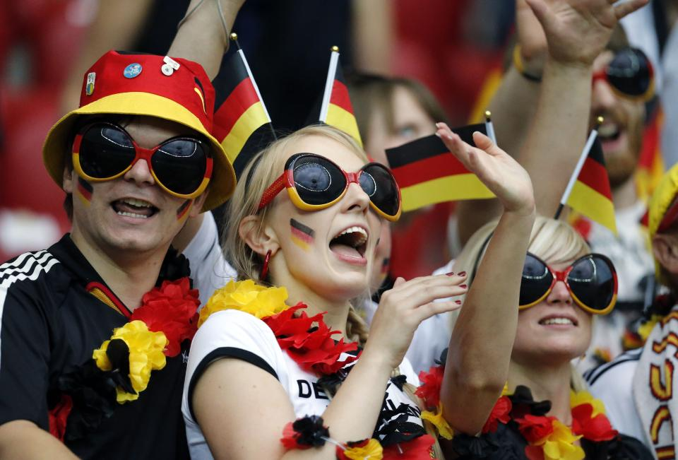 German fans cheer before the Euro 2012 soccer championship semifinal match between Germany and Italy in Warsaw, Poland, Thursday, June 28, 2012. (AP Photo/Matthias Schrader)