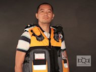 Entrepreneur Danvic Briones wears the Rescue 72 Vest Bag, a grab-and-go kit he says can store three days worth of basic supplies one needs in time of disaster.