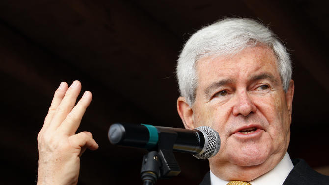 Republican presidential candidate and former House Speaker Newt Gingrich campaigns outside Mama Lou's restaurant in Robertsdale, Ala., Saturday March 10, 2012. (AP Photo/ John David Mercer)
